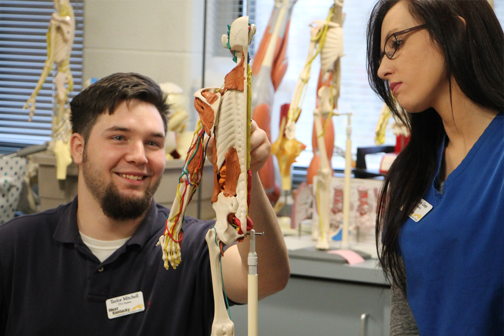 two students in the phsical therapy lab