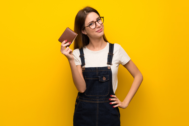 woman standing with a wallet in her hand