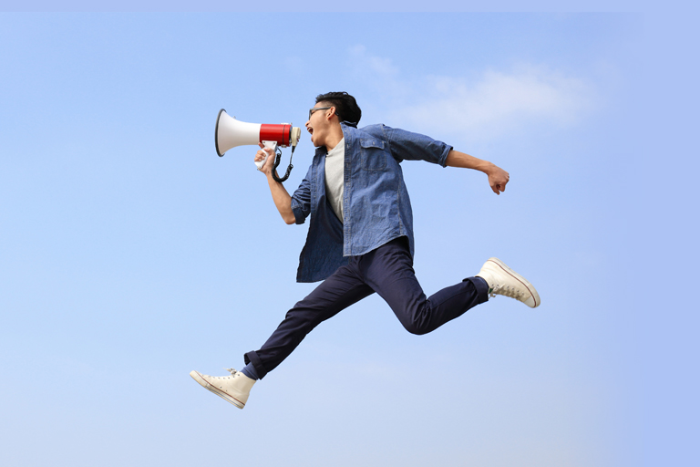 man with megaphone jumping