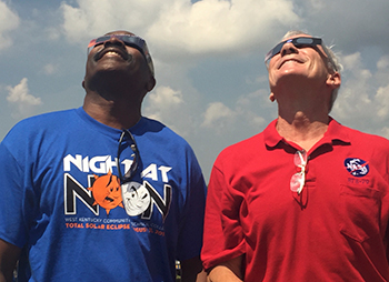WKCTC President Dr. Anton Reece and Kentucky's only astronaut and eclipse emcee Colonel Terry Wilcutt looked to the skies to see the eclipse Monday.